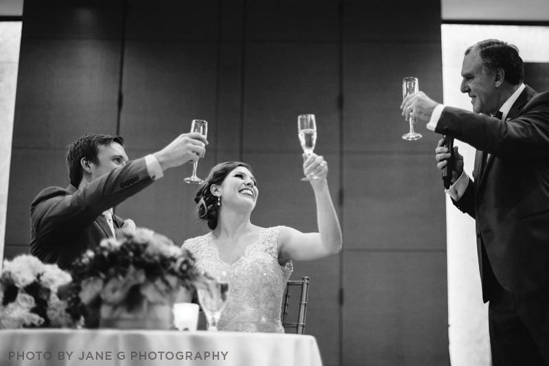 A Couple toasting JaneGPhotography
