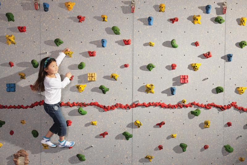 Girl_Climbing_Wall
